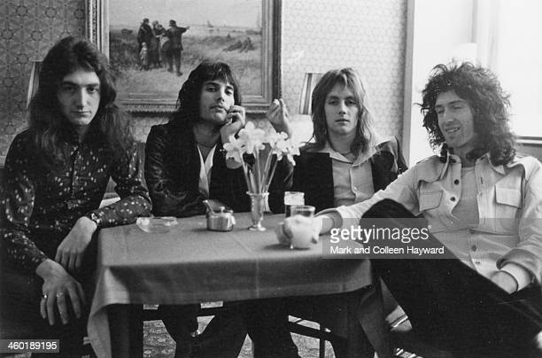 English rock group Queen posed in a cafe in the Netherlands on 22nd November 1974 Left to right John Deacon Freddie Mercury Roger Taylor and Brian May