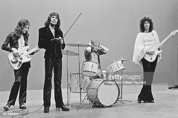 John Deacon Freddie Mercury Roger Taylor and Brian May from Queen perform on the set of the Dutch TV show TopPop on 22nd November 1974 Guitarist...