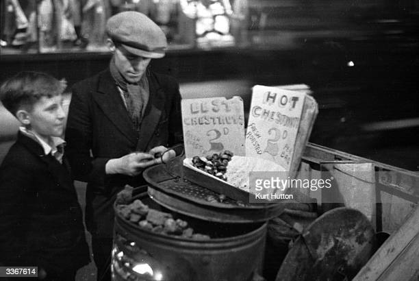 A roasted chestnut seller in Piccadilly Circus central London Original Publication Picture Post 2 In The Heart Of The Empire pub 1938