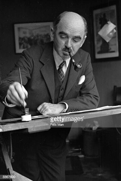British political cartoonist David Low at work in his studio in London drawing cartoons for the 'Evening Standard' newspaper. Original Publication:...