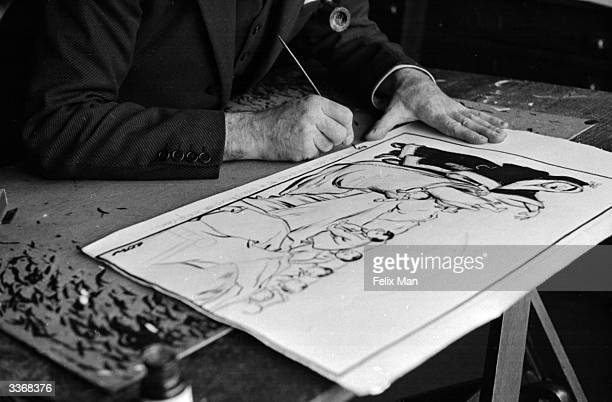 British political cartoonist David Low signing a cartoon he has drawn for the 'Evening Standard' newspaper. Original Publication: Picture Post - 23 -...