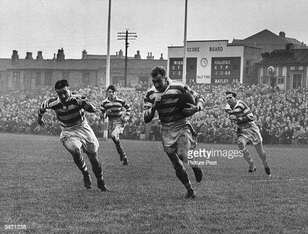 Nordgren the Wigan three quarter tears away with the ball at great speed during their match against Halifax Original Publication Picture Post 5165...