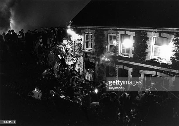 Rescue work being carried out by floodlights in Aberfan South Wales where a collapsing slag heap submerged the village school Of the 144 dead 116...