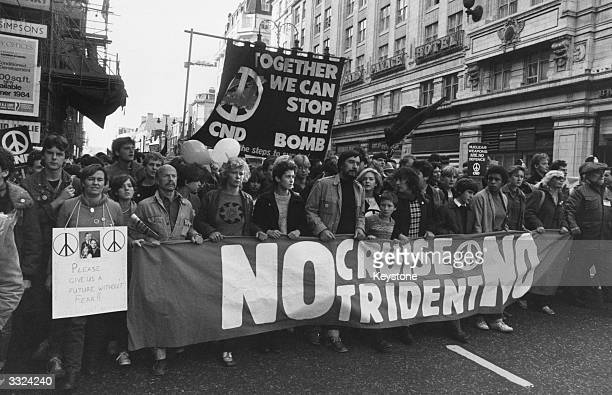 Supporters of the Campaign for Nuclear Disarmament marching through London to demonstrate against the deployment of Cruise and Trident nuclear...