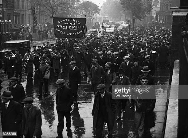 A protest march through London by the Camberwell Workers Defence Movement carrying the slogan 'United We Stand'