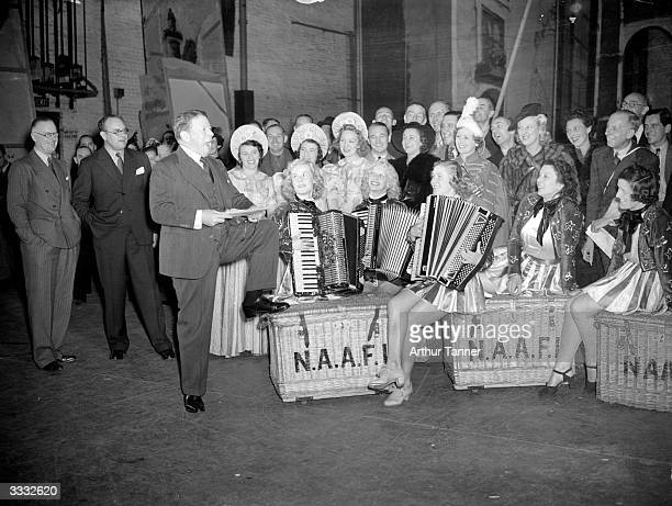 On the stage of Drury Lane theatre actor manager Sir Seymour Hicks addresses actors who are members of NAAFI an organisation set up to provide...