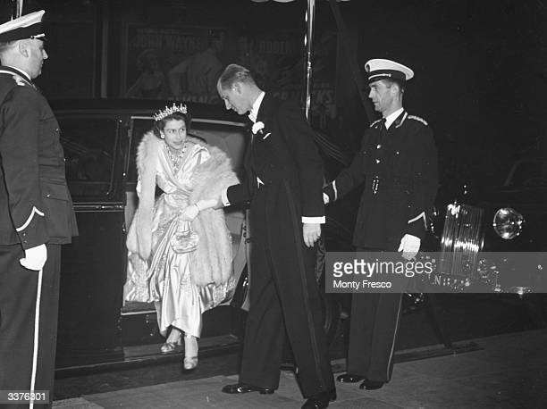 Princess Elizabeth, later Queen Elizabeth II of Great Britain, and Prince Philip attend the film premiere of 'The Lady With A Lamp' at the Warner...