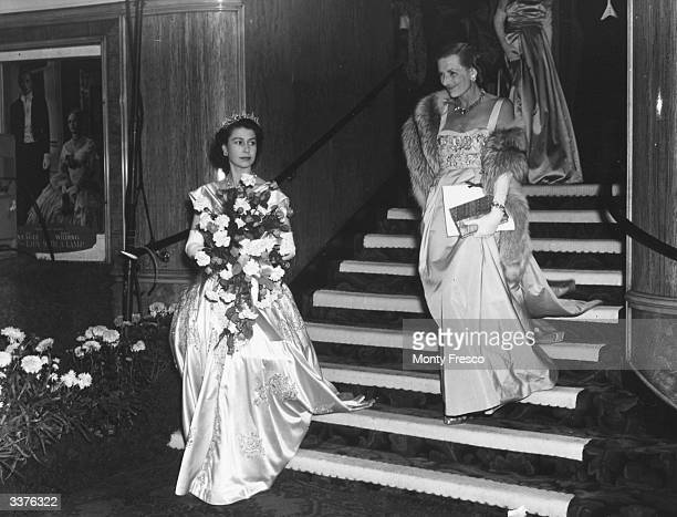 Princess Elizabeth later Queen Elizabeth II of Great Britain and Countess Mountbatten leave the film premiere of 'The Lady With A Lamp' at the Warner...