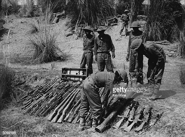 Arms captured from the Pakistan army being layed out for inspection by Indian troops during the IndiaPakistan conflict