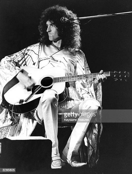 Guitarist Brian May of British glam rock pop band Queen performing to over 50000 people at an all day open air concert held in London's Hyde Park