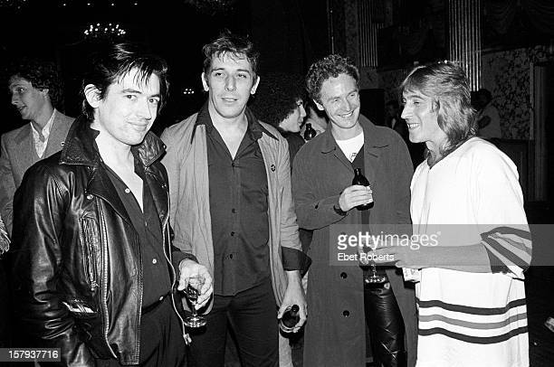 22nd SEPTEMBER: From left to right: Guitarist Chris Spedding, John Cale, Malcolm McLaren and guitarist Mick Ronson at a party for Cheap Trick at the...