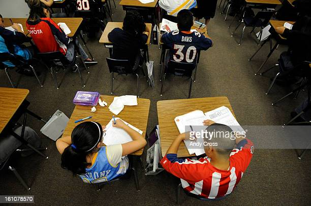 Mariah Garcia, 12-years-old, lower left, and classmate, Rafael Villela, 12-years-old, lower right, 6th graders, take a math exam West Denver...