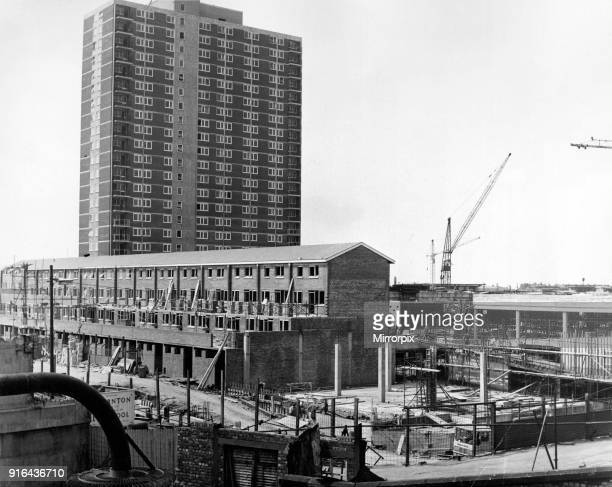 Storey block - shops at ground level and flats above - dominates the scene of more building work in the New Strand shopping centre at Bootle, 19th...