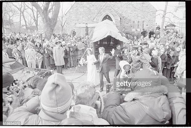2/3/79Gladwyne Pennsylvania Joseph Kennedy II and his bride the former Sheila Rauch wave to the crowd of 500 people and about 50 newsmen as they...