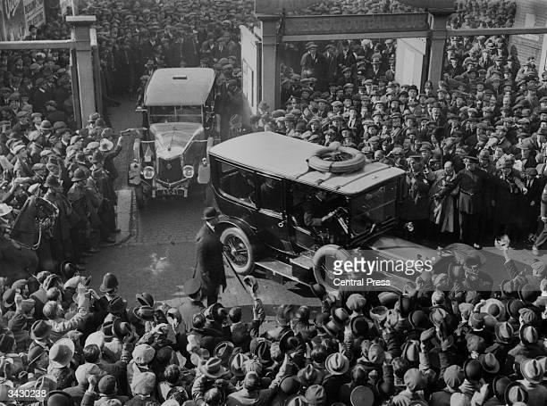 Crowds watching as members of the Tottenham Hotspur football team leaving the Stamford Bridge ground after winning the FA Cup