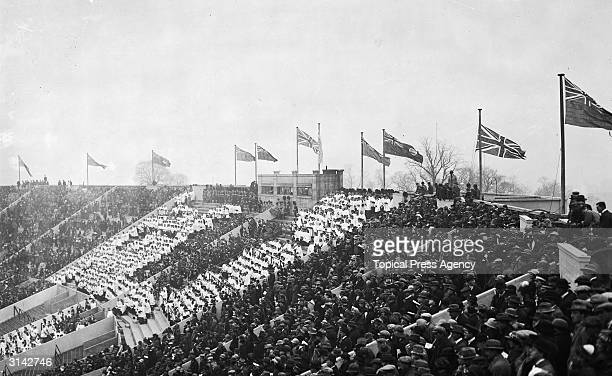 Massed crowds in the stadium at Wembley for the opening of the British Empire Exhibition at Wembley by King George V