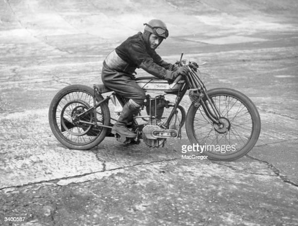 Motorcyclist A Denley on a Norton motorcycle.