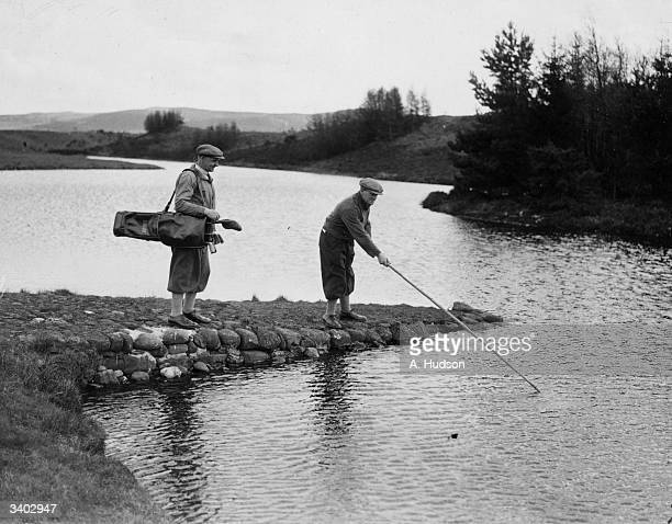 G Boyland of Brassey fishing for his ball on the Queen's Course with G Aitken of Motherwell during a championship tournament on Gleneagles Golf...