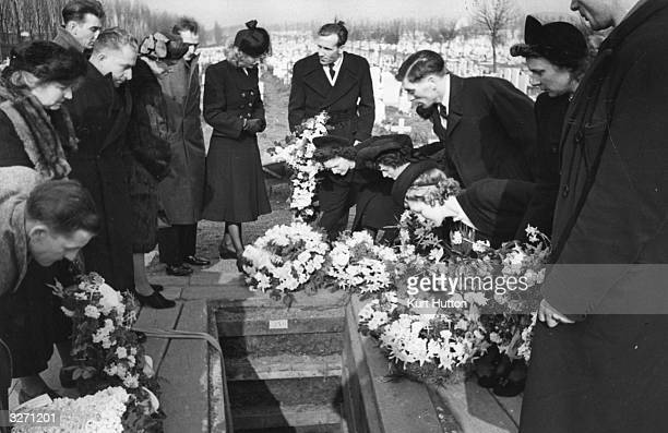 The funeral of Battersea Street Trader Jim Lloyd at Wandsworth Cemetery London Original Publication Picture Post 4753 A Coster's Funeral pub 1949