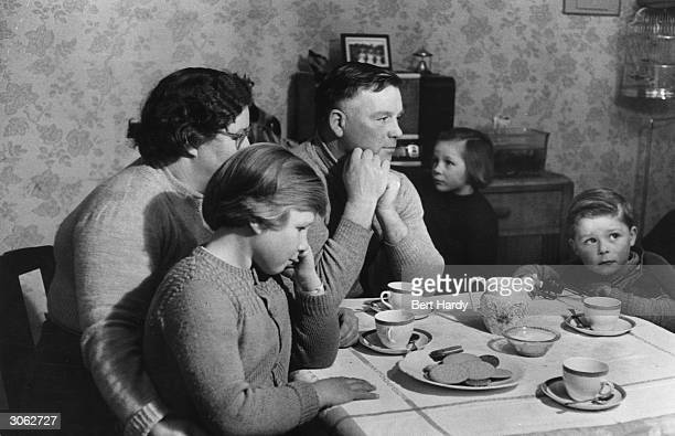 Fisherman's family listens over the tea table to a broadcast by Rev Colin Day, Minister of St Ninian's Church Arbroath who broadcasts on the trawler...