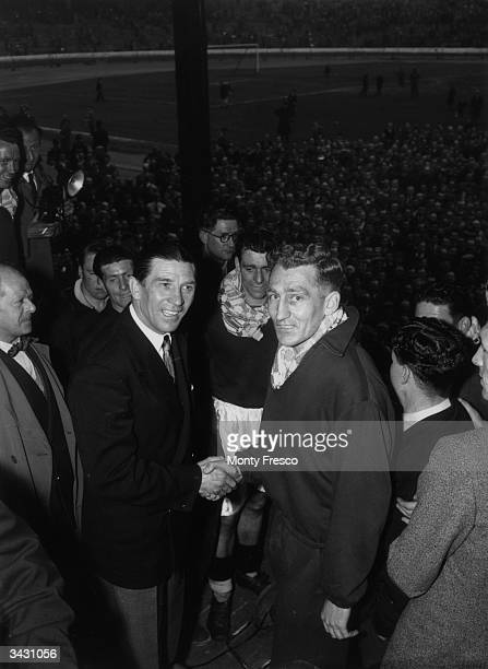 Chelsea FC manager Ted Drake congratulates captain Roy Bentley on his win against Sheffield Wednesday at Stamford Bridge, making Chelsea champions of...