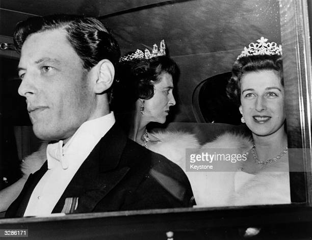 Angus Ogilvy Princess Alexandra and Princess Marina leaving Kensington Palace in their limousine to attend a ball at Windsor Castle in their honour