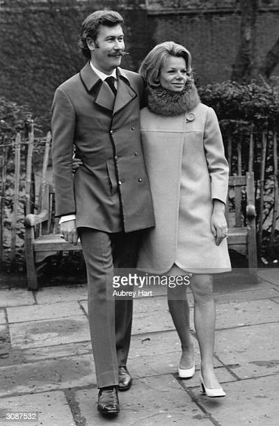 Playwright John Osborne with his wife actress Jill Bennett in the King's Road London after their wedding in the Chelsea Register Office He is wearing...