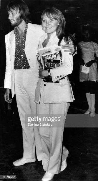 Pop singer Lulu clutches her Chekov and husband Maurice Gibb of the Bee Gees on arrival at Heathrow after their honeymoon in Acapulco Mexico