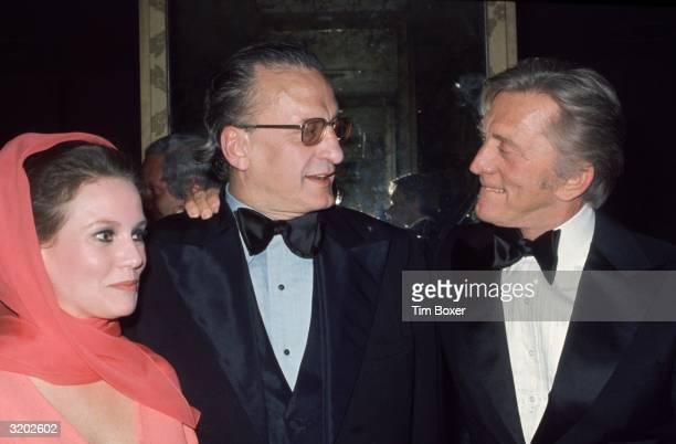 Headshot of American actors Trish Van Devere her husband George C Scott and Kirk Douglas at the Americana Hotel New York City