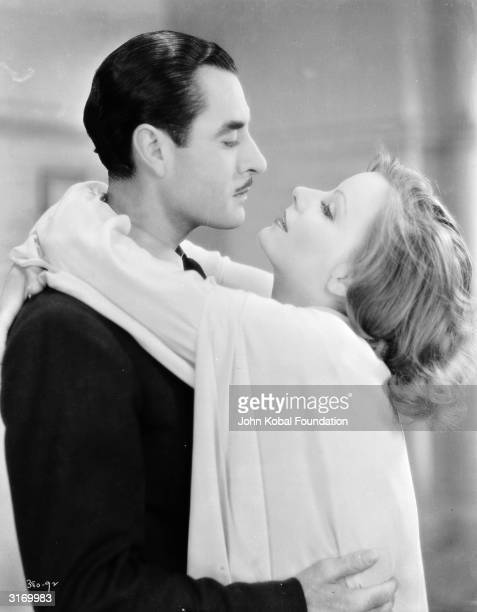 Swedish born American actress Greta Garbo and John Gilbert in the film 'A Woman of Affairs' The pair starred in several films together and their...
