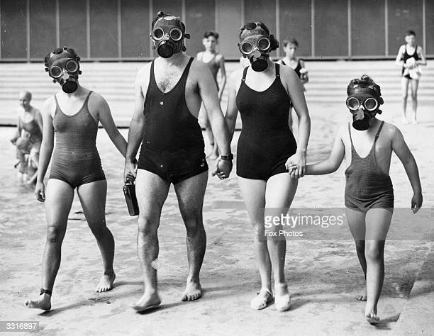 A prewar family use respirators at the Empire Pool Wembley London