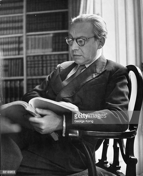Hungarian born Sir Alexander Korda film producer and mogul relaxes in the comfort of his office at 146 Piccadilly to read a new film script