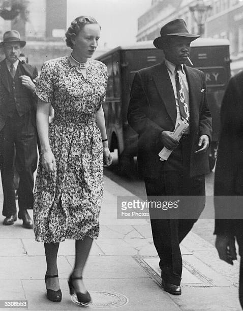 Exiled chief of the Bamangwato in Bechuanaland Seretse Khama with his wife Ruth out shopping in London