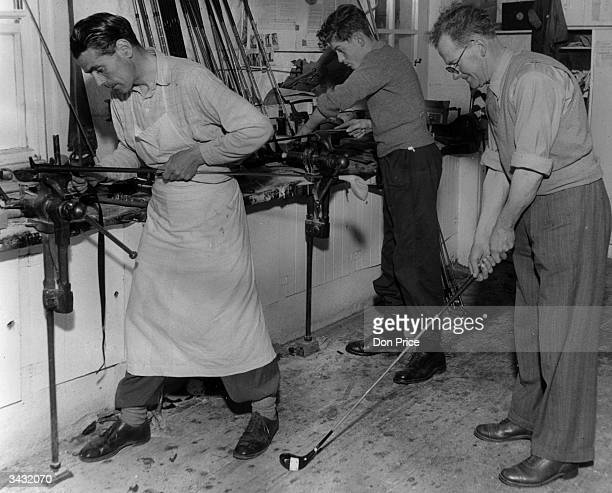 Mr Robertson the manager of Tom Morris's workshop in St Andrews tests a golf club for balance while two men work on new clubs