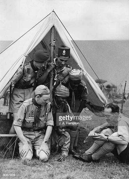 Scoutmaster W A Ingles of Barking with some scouts at the London International Patrol Camp in Gilwell Park Chingford Essex