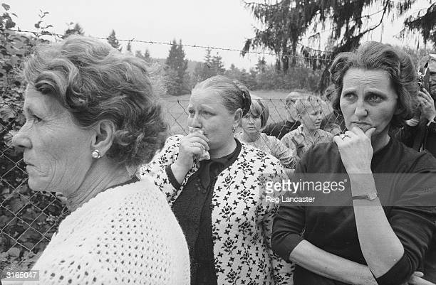 Friends and family of some of the refugees at the border between Czechoslovakia and Germany after the Soviet invasion following the 'Prague Spring'...