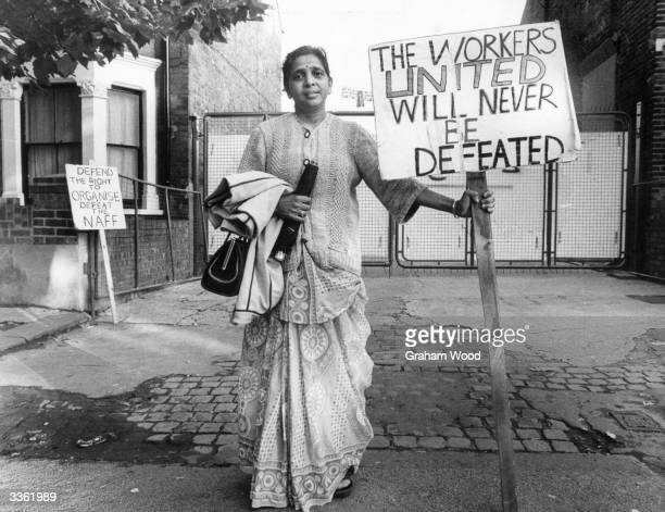 Treasurer of the Grunwick strike committee Mrs Jayaben Desai she has been picketing for a year A sign says 'Defend the Right to Organise Defeat the...