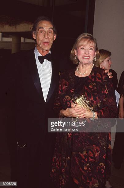 American comedian Sid Caesar and his wife Florence Levy pose at the American Comedy Honors Los Angeles California Caesar wears a tuxedo