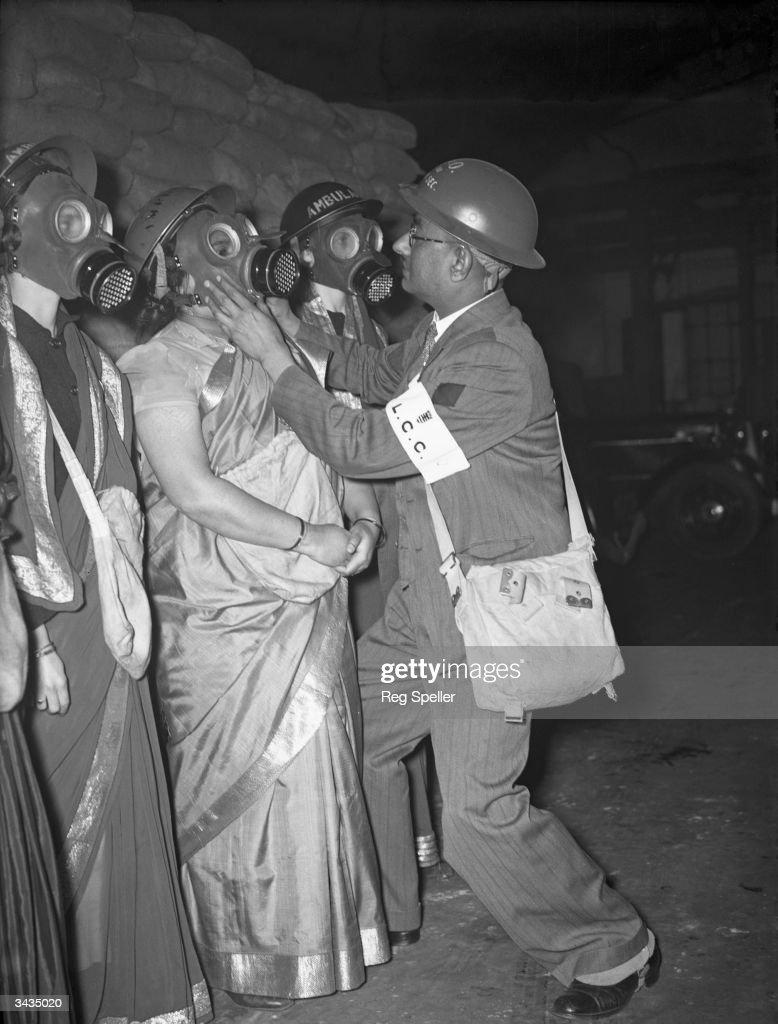 Saris And Gas Masks : News Photo