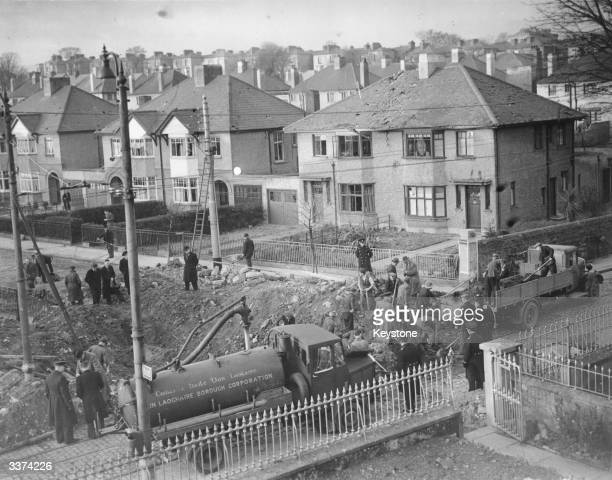 Council workers clearing up after a German bomb exploded at Sandycove County Dublin