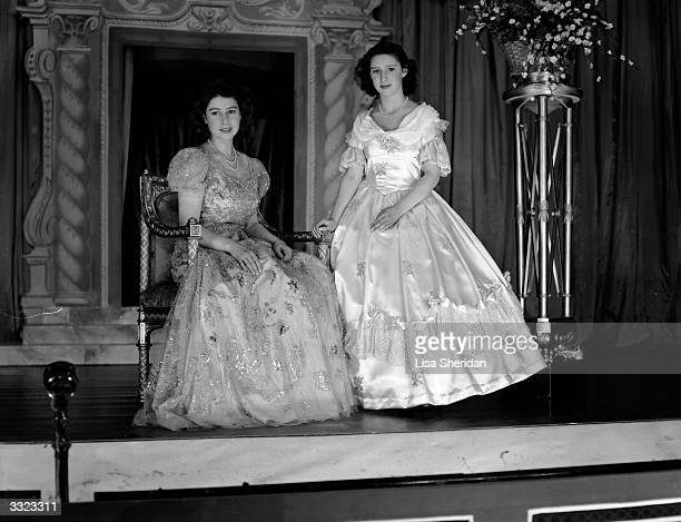 Princesses Margaret Rose and Elizabeth wearing elaborate dresses for 'Old Mother Red Riding Boots', the Christmas pantomime they are performing in at...