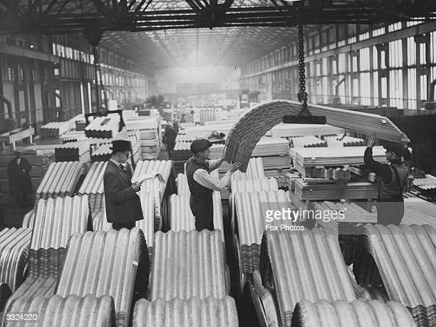 Air raid shelters under construction at the factory in Newport Wales before being transported to London The shelters are to be supplied to every...