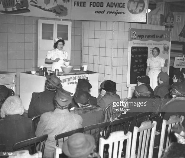 A wartime cookery demonstration taking place at a London store as part of a Free Food Advice Service