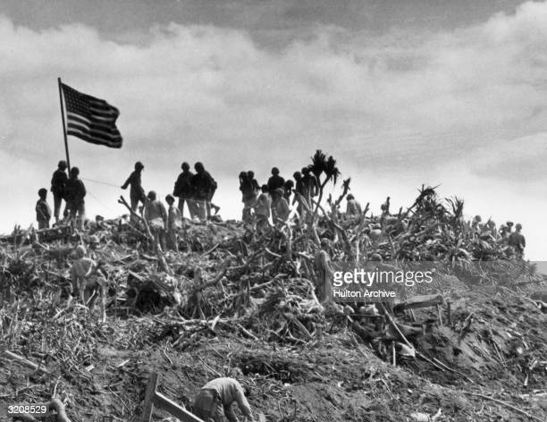 View of marines planting a US flag on Mount Suribachi Iwo Jima Japan World War II This was the second flag raised that day being larger than the first