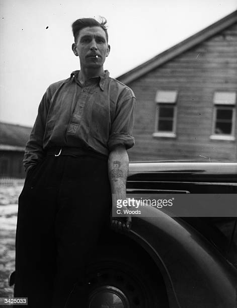 Cecil Edward Lambert, who is involved in a bigamy case, showing the tattoo on his arm which he is going to have changed into a snake.