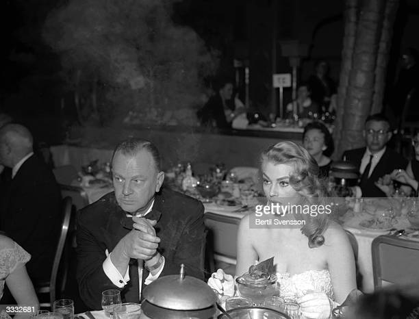 Swedish actress Anita Ekberg with her boss Bob Fellows during the Golden Globe Awards ceremony banquet at the Cocoanut Grove Restaurant in Hollywood