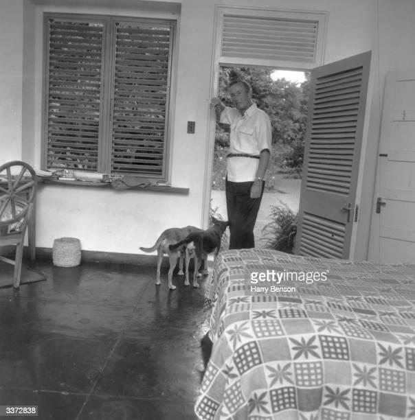 British writer Ian Fleming at his home Goldeneye in Jamaica
