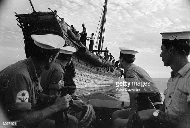 Men from the Royal Navy minesweeper HMS Calton patrol the seas around Aden searching for dhows running guns to the terrorists during the country's...