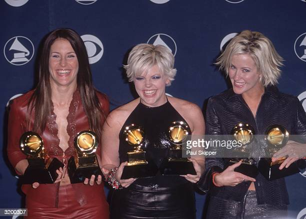American Country group the Dixie Chicks Emily Robinson Natalie Meines and Martie Seidel hold their Grammy awards won for Best Country Album and Best...