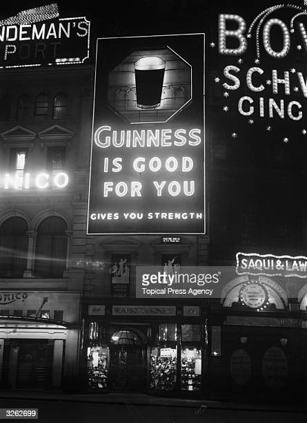 An electric light sign advertising Guinness at Piccadilly Circus London